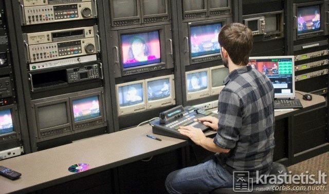Watertown, Massachusetts, USA --- Video editor at work in a TV editing control room at a Cable TV Studio --- Image by © Mark Hunt/Huntstock/Corbis
